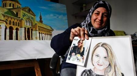 Syrian artist, war refugee draws portraits of Paris victims