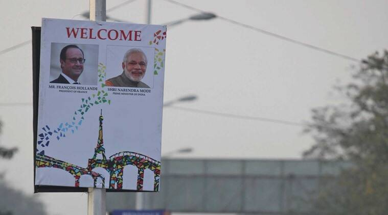 Hoardings with photographs of French President Francois Hollande and Narendra Modi displayed on the street light poles on Madhya Marg in Chandigarh. Express Photo by Kamleshwar Singh