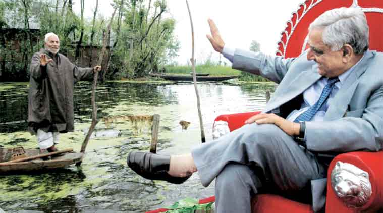 Mufti Mohammad Sayeed waves to an admirer on the Dal Lake.