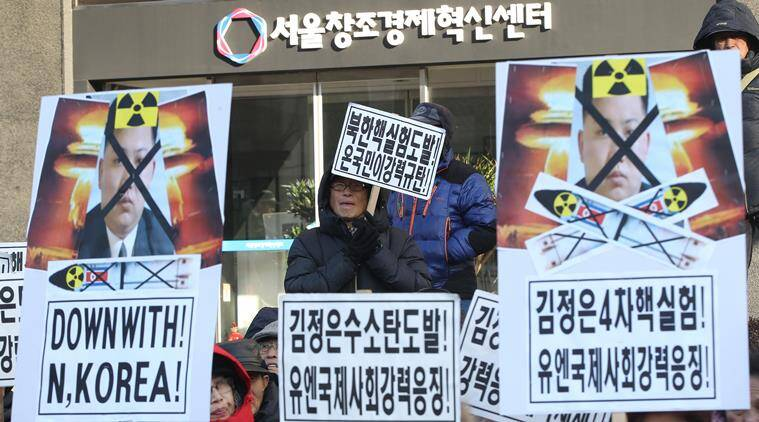 """South Korean protesters with defaced photos of North Korean leader Kim Jong Un stage a rally during a rally against North Korea's announcement that it had tested a hydrogen bomb in Seoul, South Korea, Thursday, Jan. 7, 2016. The United States, South Korea and Japan agreed to launch a """"united and strong"""" international response to North Korea's apparent fourth nuclear test, as experts scrambled Thursday to find more details about the detonation that drew worldwide skepticism and condemnation. The letters reads """"Punish North Korea for its threats and provocations! and denounce North Korean's fourth nuclear test.""""(AP Photo/Ahn Young-joon)"""
