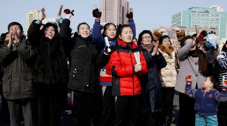 North Koreans react as they watch a news broadcast on a video screen outside Pyongyang Railway Station in Pyongyang, North Korea, Wednesday, Jan. 6, 2016. North Korea said Wednesday it had conducted a hydrogen bomb test, a defiant and surprising move that, if confirmed, would put Pyongyang a big step closer toward improving its still-limited nuclear arsenal. (AP Photo/Kim Kwang Hyon)