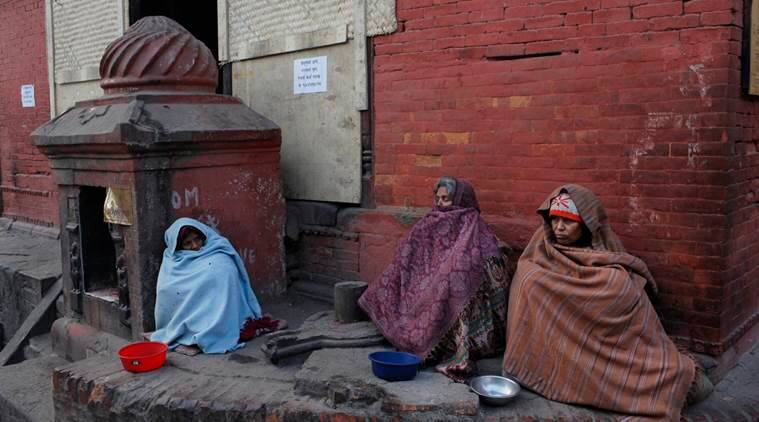 Nepalese women sit and wait for alms near Pashupatinath temple premises in Kathmandu, Nepal, Monday, Jan. 18, 2016. The world's political and business elite are being urged to do more than pay lip service to growing inequalities around the world as they head off for this week's World Economic Forum in the Swiss ski resort of Davos. According to Oxfam, the scale of the problem is increasingly stark: just 62 people, it says, own the same wealth as half the planet. The compares with 388 people just five years ago, when the global economy was just emerging from its deepest recession since World War II. (AP Photo/Niranjan Shrestha)