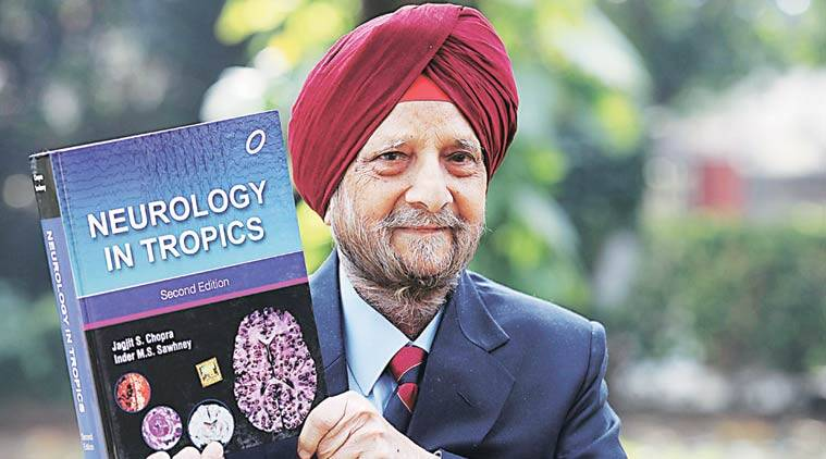 Dr Jagjit S Chopra with his book Neurology in Tropics in Chandigarh.  (Express Photo by Jaipal Singh)