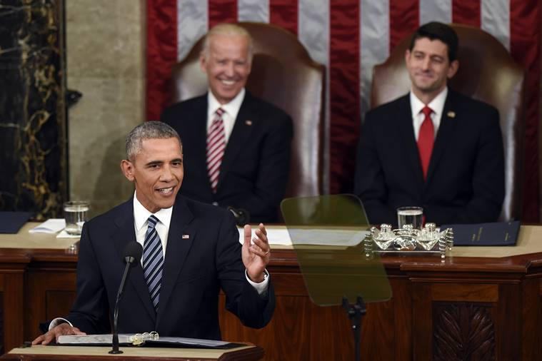 Vice President Joe Biden and House Speaker Paul Ryan of Wis., listen as President Barack Obama gives his State of the Union address to a joint session of Congress on Capitol Hill in Washington. (AP Photo/Susan Walsh)