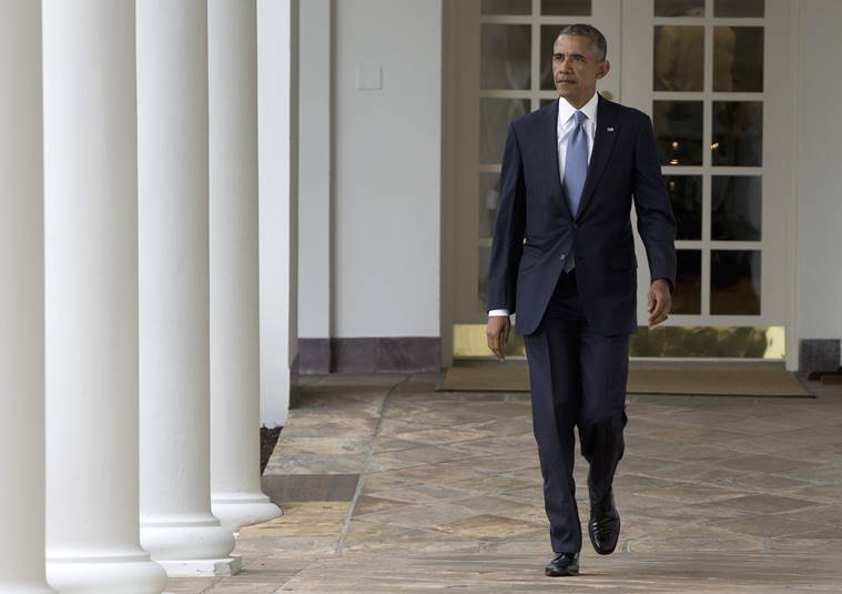 President Barack Obama walks along the colonnade of the White House in Washington, to the residence from the Oval Office, hours before giving his State Of The Union address. (AP Photo/Carolyn Kaster)