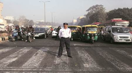 With flowers and volunteers, traffic police gear up for odd-evenplan