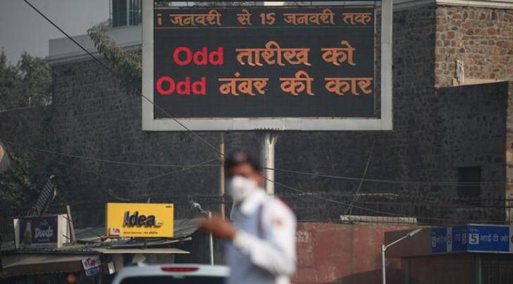 Motorists at the ITO (New Delhi) undergo a Delhi government ODDEVEN trail run early thursday morning, during which the traffic policemen and Civil defense members managed the traffic and held out posters narrating about the traffic arrangments to be starting this new year. Express Photo by Tashi Tobgyal New Delhi 311215