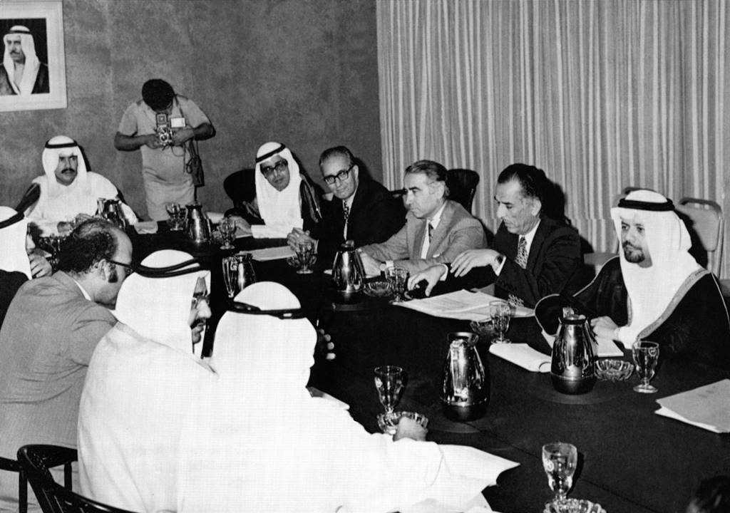 In this Nov. 3, 1973 file photo, a subcommittee of six Organization of Petroleum Exporting Countries (OPEC) meet to study the prices of oil, in Kuwait. The meeting comprises of Oil Ministers from Kuwait, Saudi Arabia, Iraq, Iran, Abu Dhabi and Qatar. AP Photo/File