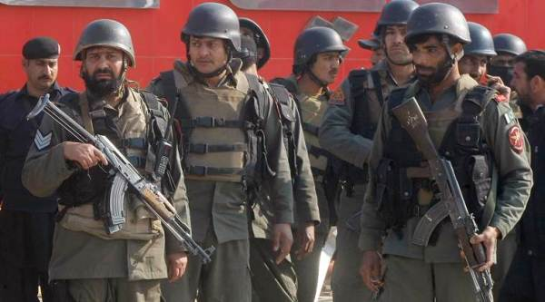 Pakistani troops arrive at Bacha Khan University in Charsadda, some 35 kilometers (21 miles) outside the city of Peshawar, Pakistan, Wednesday, Jan. 20, 2016. Gunmen stormed Bacha Khan University named after the founder of an anti-Taliban political party in the country's northwest Wednesday, killing several people, officials said. (AP Photo/Mohammad Sajjad)