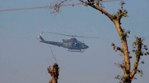 A Pakistan army helicopter flies over the Bacha Khan University. (Source: AP)