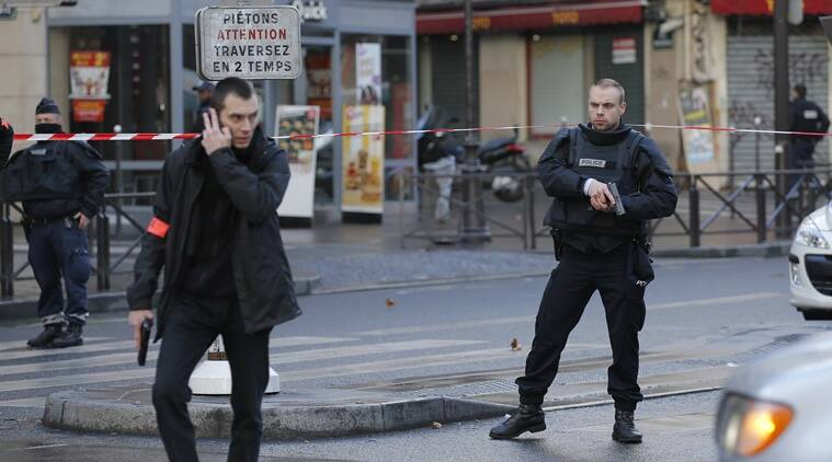 paris attack, man shot in paris, paris police, man attacks paris police station, ISIS, charlie hebdo, hebdo anniversary