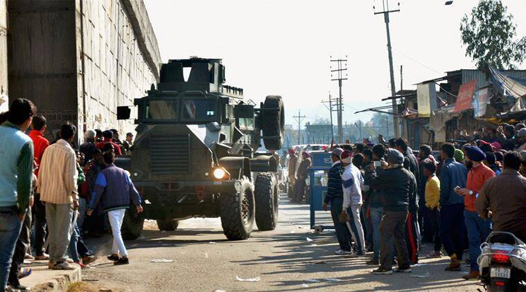 Pathankot: An armored vehicle moves near the Indian Air Force base that was attacked by militants in Pathankot, Punjab on Saturday. PTI Photo (PTI1_2_2016_000051B)