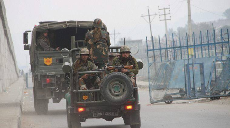 Army personnel move in vehicles during the operation against the militants at the Indian Air Force base in Pathankot. (Source: PTI)