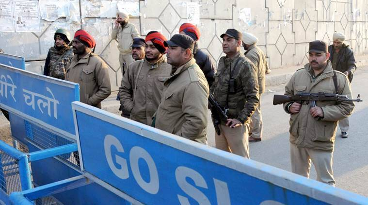 CAPTION- Security personnel checking at road near the IAF base which was attacked by militants in Pathankot on Sunday, January 3 2016. EXPRESS PHOTO BY RANA SIMRANJIT SINGH