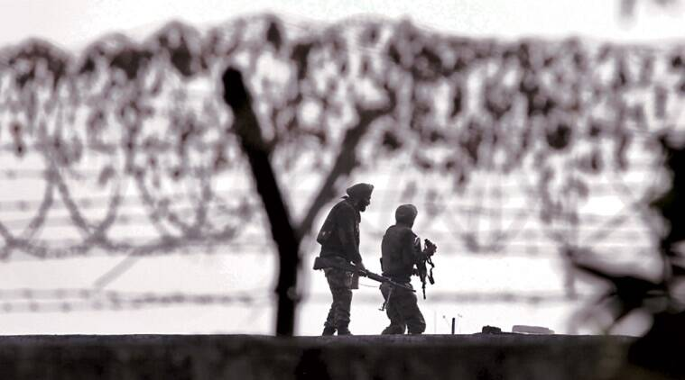 Security personnel at the perimeter fence of the Indian Air Force base in Pathankot on Wednesday. (Express Photo by: Gurmeet Singh)