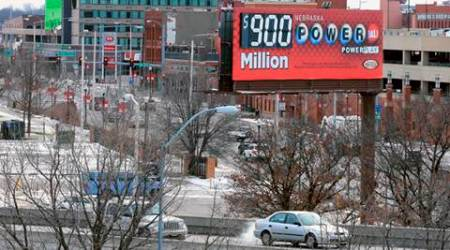 A billboard advertises the Powerball jackpot in Lincoln, Neb., Saturday, Jan. 9, 2016. The estimated $900 million jackpot makes it the biggest in U.S. history. (AP Photo/Nati Harnik)