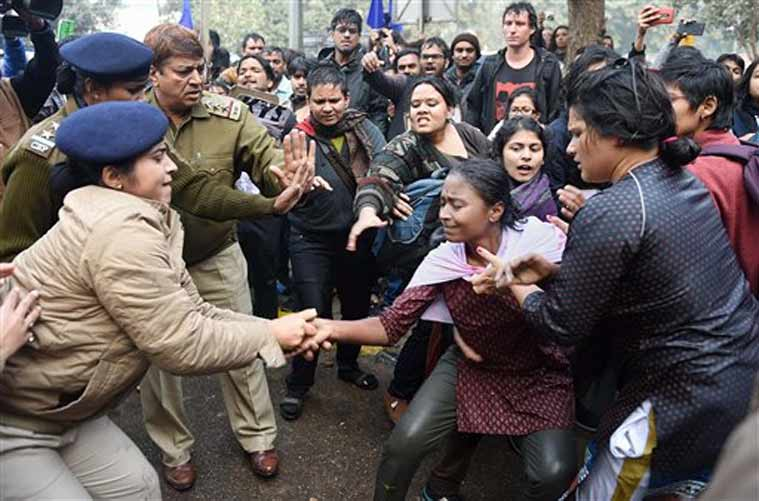 Police detain a girl students during a protest against the Ministry of Human Resource Development in New Delhi on Monday over the suicide of a PhD scholar Rohith Vemula at University of Hyderabad. (PTI Photo)