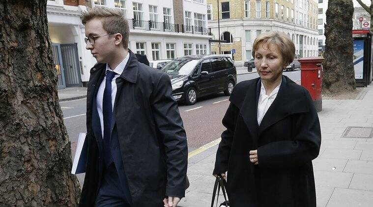 Marina Litvinenko, widow of former Russian spy Alexander Litvinenko, and their son Anatoly arrive at Matrix Chambers on Gray's Inn for a press conference in London, Thursday Jan. 21, 2016. President Vladimir Putin probably approved a plan by Russia's FSB security service to kill former agent Alexander Litvinenko, a British judge said Thursday. (AP Photo/Tim Ireland)