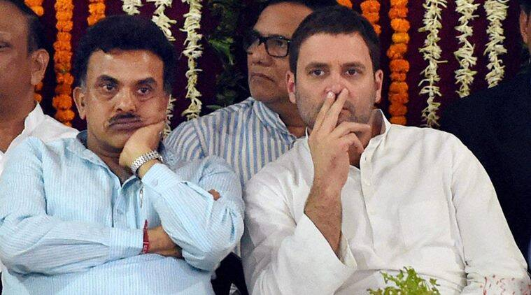 Congress Vice-President Rahul Gandhi with party leader Sanjay Nirupam during the inauguration of an auditorium named after Murli Deora at the Mumbai Pradesh Congress Committee office in Mumbai on Friday. (PTI Photo)