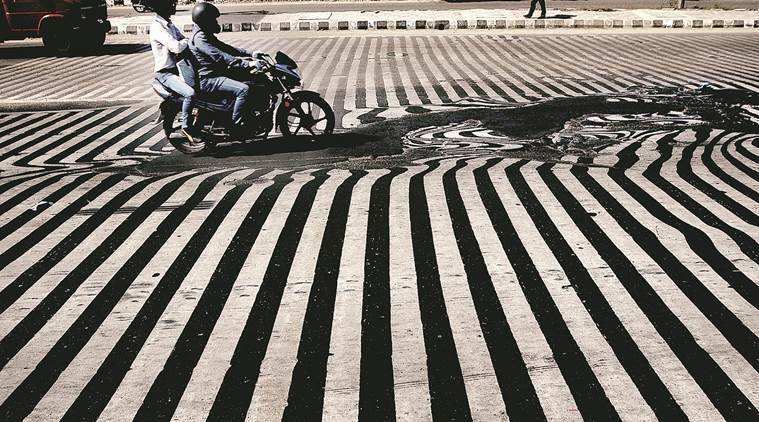 Melted road due to heat in New Delhi. (Express photo by  Praveen Khanna)