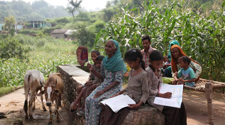 Rita and Neelam Class 2nd students doing their homework before Sunset at village Kamradhi Block in Morni due to No Electricity Connection in the Village in District Panchkula on Thursday, August 27 2015. Express Photo by Kamleshwar Singh