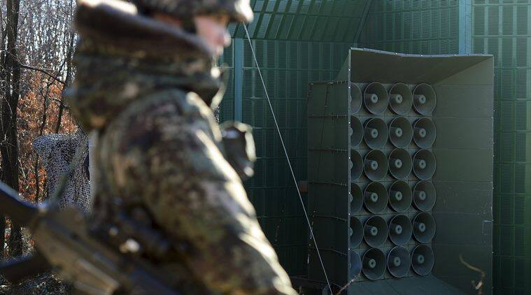 A South Korean soldier stands near the loudspeakers near the border area between South Korea and North Korea in Yeoncheon, South Korea, Friday, Jan. 8, 2016. South Korea responded to North Korea's nuclear test with broadcasts of anti-Pyongyang propaganda across the rival's tense border Friday, believed to be the birthday of North Korean leader Kim Jong Un. (Lim Tae-hoon/Newsis via AP)
