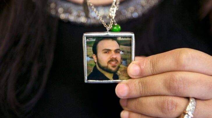 FILE - In this June 2, 2015 file photo, Naghmeh Abedini holds a necklace with a photograph of her husband, Saeed Abedini, on Capitol Hill in Washington.  (AP Photo/Jacquelyn Martin, File)