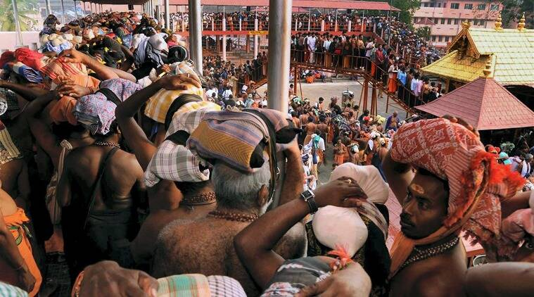 In the name of god: Devotees at the Sabarimala shrine. (Express Archive)