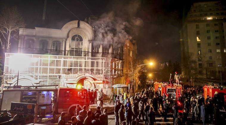 Smoke rises as Iranian protesters set fire to the Saudi embassy in Tehran, Sunday. Protesters upset over the execution of a Shiite cleric in Saudi Arabia set fires to the Saudi embassy in Tehran. AP Photo