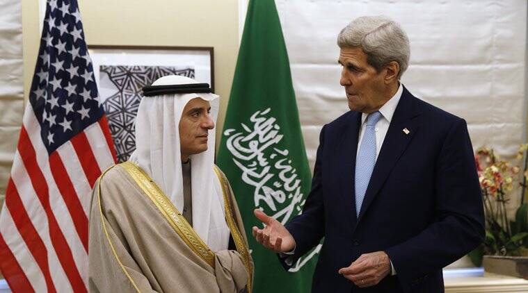 U.S. Secretary of State John Kerry, right, speaks during his meeting with Saudi Arabia's Foreign Minister, Adel al-Jubeir, in London Thursday, Jan. 14, 2016. The two met to discuss Syria and Iran and condemned the bombings in Jakarta. (Kevin Lamarque/Pool Photo via AP)
