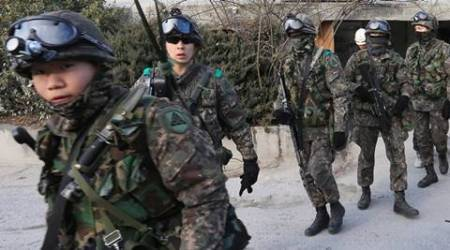 South Korean army soldiers gather to search for suspected North Korean leaflets in Seoul, South Korea, Wednesday, Jan. 13, 2016. South Korean military announced Wednesday it has found hundreds of anti-South Korea leaflets near the western portion of the Koreas' border. (Hong Hae-in/Yonhap via AP) KOREA OUT