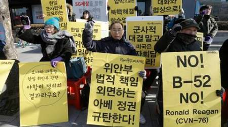 "Protesters shout slogans during a rally demanding a restart of peace talks between two Koreas and six-party talks, in Seoul, South Korea, Tuesday, Jan. 12, 2016. North Korean leader Kim Jong Un looked Monday to milk his country's recent nuclear test as a propaganda victory, praising his scientists and vowing more nuclear bombs a day after the U.S. flew a powerful nuclear-capable warplane close to the North in a show of force. The placards read ""Start the meeting between two Koreas and six-party talks"" and  ""Peace instead of war."" (AP Photo/Ahn Young-joon)"