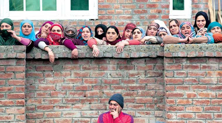 People watch Owais's funeral procession in Srinagar. (Source: AP)