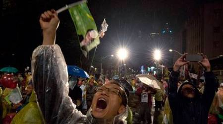 A supporter of Taiwan's Democratic Progressive Party presidential candidate Tsai Ing-wen cheers at a rally before polling day in Banqiao district of Taipei, Taiwan, Friday, Jan. 15, 2016. Taiwan will hold its presidential election on Jan. 16, 2016. (AP Photo/Ng Han Guan)