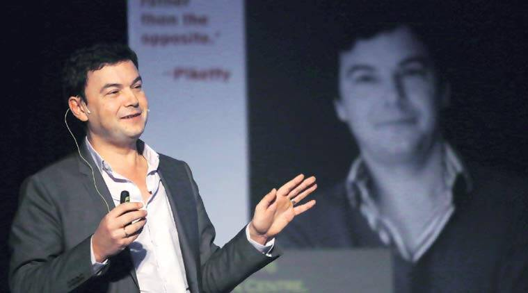 Thomas Piketty delivers a lecture at Jawaharlal Nehru University in Delhi on Thursday. (Express Photo by: Tashi Tobgyal)