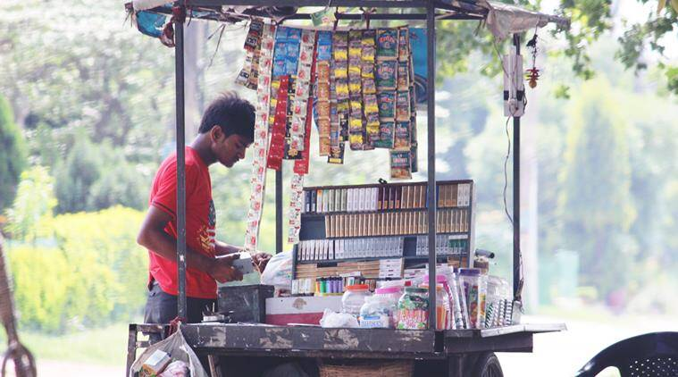 A tobacco seller selling tobacco products on roadside at Sector 7-8 Dividing road in Panchkula on Monday, July 07 2014. Photo by Nipun Sharma