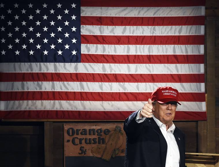 Republican presidential candidate Donald Trump arrives on stage before speaking during a campaign stop in Gilbert. AP Photo