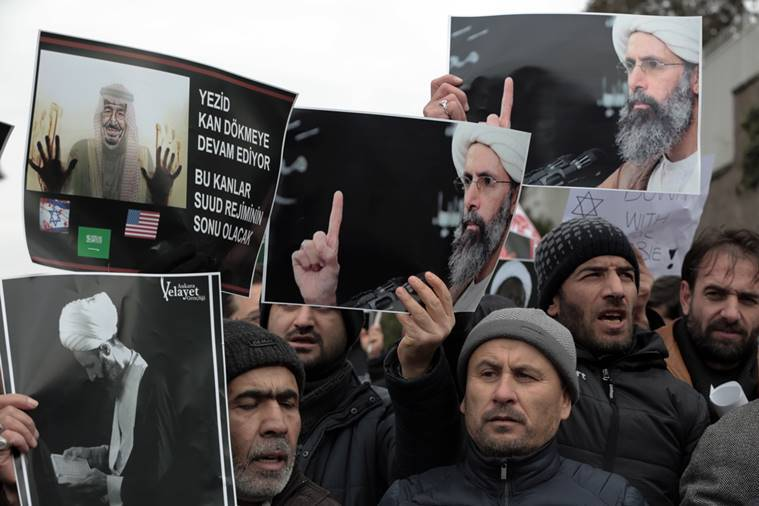 Iranian and Turkish demonstrators hold pictures of Shiite cleric Sheikh Nimr al-Nimr as they protest outside the Saudi Embassy in Ankara, Turkey. AP Photo