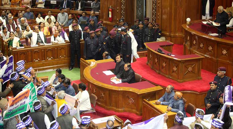 BSP, Congress and RLD MLAs protest during the Governor's address in the UP Assembly Friday. (Express Photo by Vishal Srivastav)