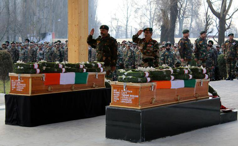 GOC 15 Corps Satish Dua offers tribute to Captain Tushar Mahajan and Lance Naik who were killed during an encounter with militants at Pampore south kashmir on Monday. The encounter that started on saturday (FEB 20) entered third day on Monday. (EXPRESS PHOTO BY SHUAIB MASOODI)