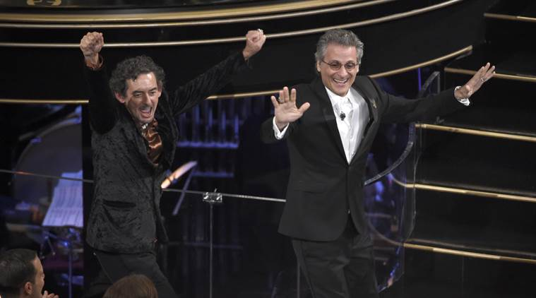 "David White, left, and Mark Mangini accept the award for best sound editing for ""Mad Max: Fury Road"" at the Oscars. (Source: AP)"