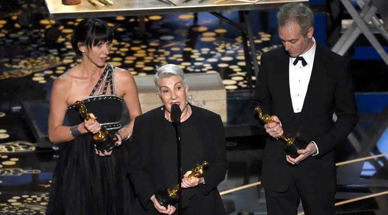 "Elka Wardega, from left, Lesley Vanderwalt, and Damian Martin accept the award for best makeup and hairstyling for ""Mad Max: Fury Road"". (Source: AP)"