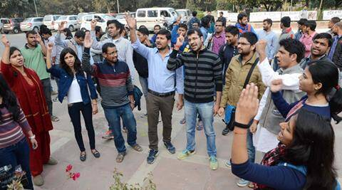 New Delhi: Students affiliated to the Akhil Bharatiya Vidyarthi Parishad (ABVP) protest outside the office of the vice chancellor of Jawaharlal Nehru University (JNU) in New Delhi on Wednesday to vent their ire over a programme describing the execution of 2001 Parliament attack convict Afzal Guru as 'judicial killing'.  PTI Photo  (PTI2_10_2016_000237A)