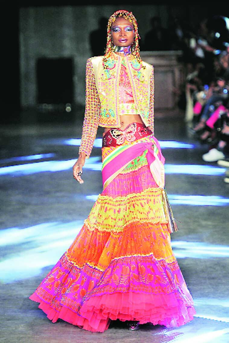 Manish Arora with Ambassador of France Francois Richier (above); a model in Arora's latest Spring-Summer 2016 line showcased at Paris Fashion Week in October, 2015