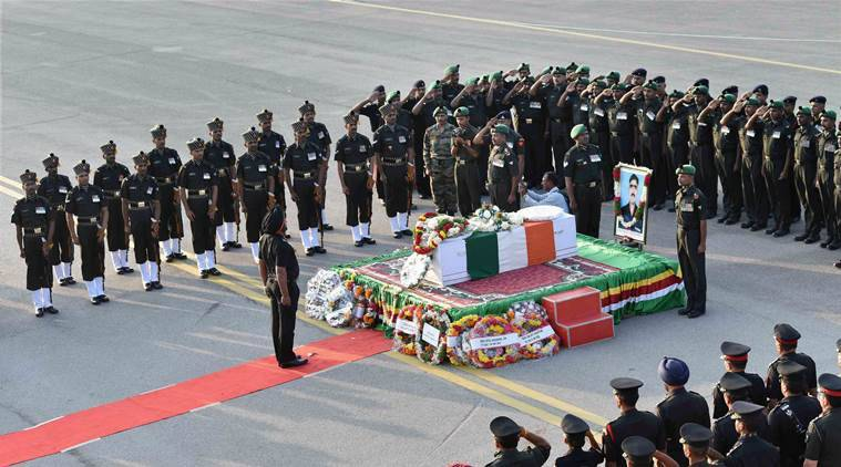 Hyderabad: Soldiers paying tribute to the mortal remains of Sepoy Mushtaq Ahmed who died in Siachen avalanche, at the old airport in Begumpet, Hyderabad on Monday. PTI Photo (PTI2_15_2016_000294B)