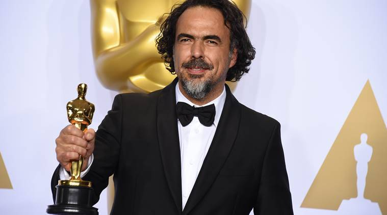 "Alejandro G. Inarritu poses in the press room with the award for best director for ""The Revenant"" at the Oscars. (Source: AP)"