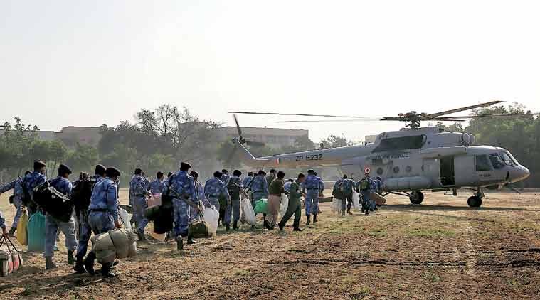 RAF personnel board an IAF helicopter at Bahadurgarh to reach violence-hit towns of Haryana Sunday. (Express Photo Ravi Kanojia)