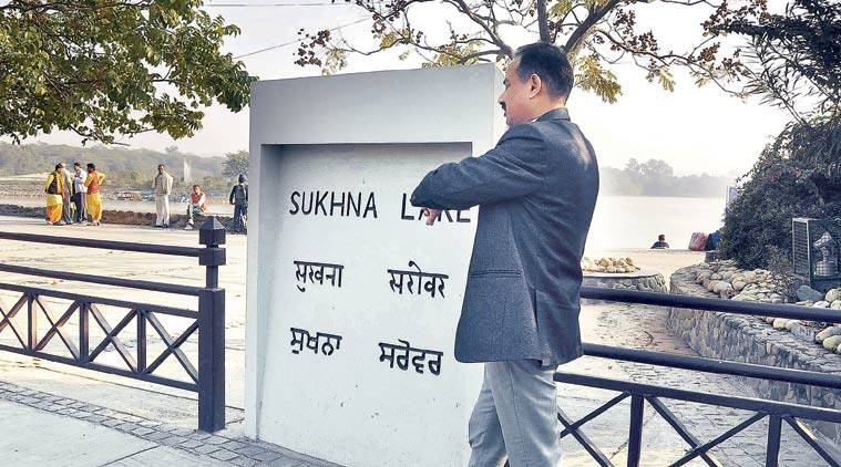 Mayor Arun Sood waits for municipal officials at Sukhna Lake in Chandigarh Wednesday.  Sahil Walia