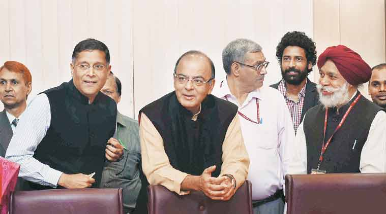 Finance Minister Arun Jaitley poses for a group photo with the members of the Economic Division who assisted in the preparation of Economic Survey in New Delhi on Thursday. CEA Arvind Subramanian is also seen. (Source: PTI)
