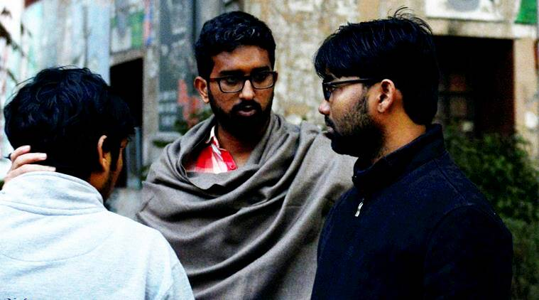 JNU student Ashutosh Kumar (R) who faces charges of sedition at JNU campus in New Delhi on Thursday. (PTI Photo by Kamal Singh)